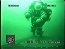 The turkish diver has work in the hard diving suit on a submarine